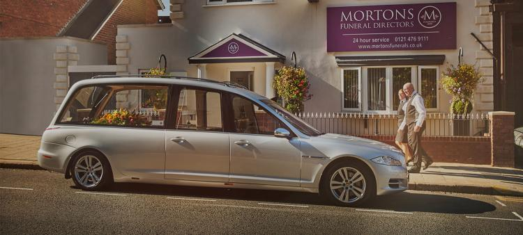 Silver hearses outside Mortons Funeral Directors head office in Birmingham