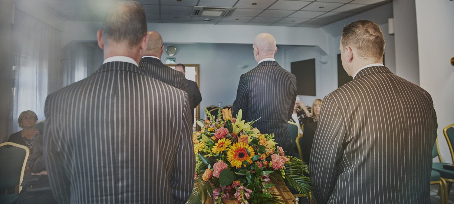 Couple attending funeral in the Ivy Suite