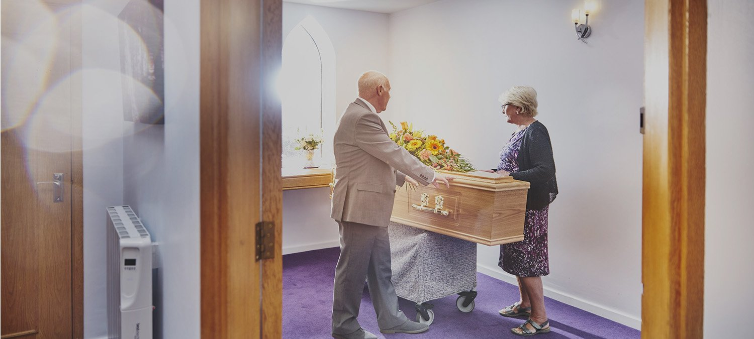 Couple saying goodbye to a loved one in Mortons Chapel of Rest